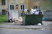 Platform with the garbage container and a dump of household wast — Stock Photo