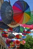 GUSEV, RUSSIA - JUNE 04, 2015: Color umbrellas hang on the stree — Zdjęcie stockowe