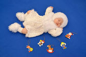 The sleeping baby in a New Year's suit of the Snowflake with Chr — Stock Photo