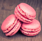 Pink macaroons on retro vintage wooden background  — Stock Photo