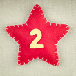Red star with wooden number 2 on vintage fabric background — Stock Photo #58500263