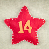 Red star with wooden number 14 on vintage fabric background — Stock Photo