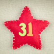 Concept for new year, red star with wooden numbers 31 on vintage — Stock Photo #58534243