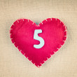 Red heart with wooden number 5 on vintage fabric background — Stock Photo #65872035