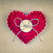 Red heart with an old wooden button and a bow made out of string — Stock Photo #65872175