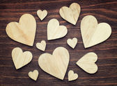 Various sized wooden hearts with a good composition  on a vintag — Stock Photo