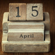 A very old wooden vintage calendar showing the date 15th April o — Stock Photo #65888389