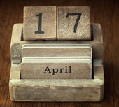 A very old wooden vintage calendar showing the date 17th April o — Stock Photo