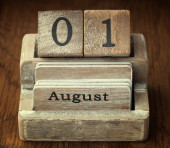 A very old wooden vintage calendar showing the date 1st August o — Stockfoto
