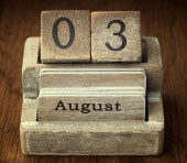A very old wooden vintage calendar showing the date 3rd August o — Stock Photo