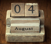 A very old wooden vintage calendar showing the date 4th August o — Stock Photo