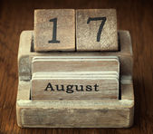 A very old wooden vintage calendar showing the date 17th August  — Stock Photo
