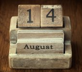 A very old wooden vintage calendar showing the date 14th August  — Stock Photo