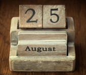 A very old wooden vintage calendar showing the date 25th August — Stock Photo