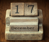 A very old wooden vintage calendar showing the date of 17th Dece — Stock Photo