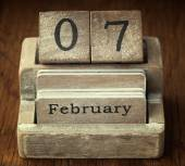 A very old wooden vintage calendar showing the date 7th February — Stock Photo