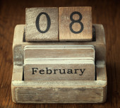 A very old wooden vintage calendar showing the date 8th February — Stock Photo