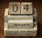 A very old wooden vintage calendar showing the date 4th January — Stock Photo