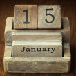 A very old wooden vintage calendar showing the date 15th January — Stock Photo #65980229