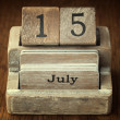A very old wooden vintage calendar showing the date 15th July on — Stock Photo #65983393