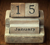 A very old wooden vintage calendar showing the date 15th January — Stock Photo