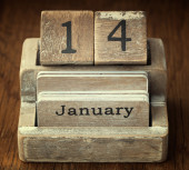 A very old wooden vintage calendar showing the date 14th January — Stock Photo