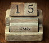 A very old wooden vintage calendar showing the date 15th July on — Stock Photo