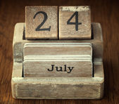 A very old wooden vintage calendar showing the date 24th July on — Stock Photo