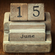 A very old wooden vintage calendar showing the date 15th June on — Stock Photo #65995667