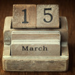 A very old wooden vintage calendar showing the date 15th March o — Stock Photo #65998895