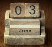 A very old wooden vintage calendar showing the date 3rd June on  — Foto de Stock