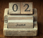 A very old wooden vintage calendar showing the date 2nd June on  — Foto de Stock