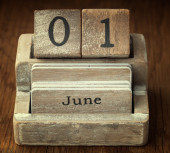 A very old wooden vintage calendar showing the date 1st June on  — Foto de Stock