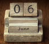 A very old wooden vintage calendar showing the date 6th June on  — Stok fotoğraf