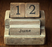A very old wooden vintage calendar showing the date 12th June on — Stock Photo