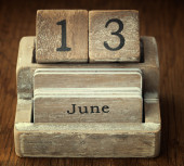 A very old wooden vintage calendar showing the date 13th June on — Foto de Stock