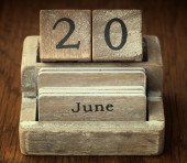 A very old wooden vintage calendar showing the date 20th June on — Stock Photo