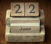 A very old wooden vintage calendar showing the date 22nd June on — Stock Photo