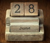 A very old wooden vintage calendar showing the date 28th June on — Stock Photo