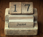 A very old wooden vintage calendar showing the date 17th June on — Stock Photo