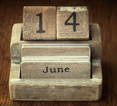 A very old wooden vintage calendar showing the date 14th June on — Stock Photo