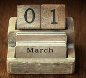 A very old wooden vintage calendar showing the date 1st March on — Foto de Stock