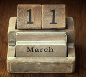 A very old wooden vintage calendar showing the date 11th March o — Foto de Stock