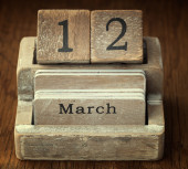 A very old wooden vintage calendar showing the date 12th March o — Foto de Stock