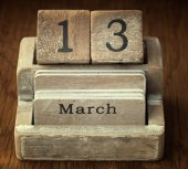 A very old wooden vintage calendar showing the date 13th March o — Foto de Stock