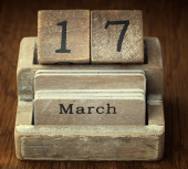 A very old wooden vintage calendar showing the date 17th March o — Stock Photo
