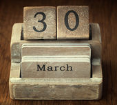 A very old wooden vintage calendar showing the date 30th March o — Foto de Stock