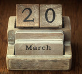 A very old wooden vintage calendar showing the date 20th March o — Foto de Stock
