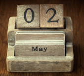 A very old wooden vintage calendar showing the date 2nd May on w — Foto de Stock