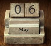 A very old wooden vintage calendar showing the date 6th May on w — Stock Photo